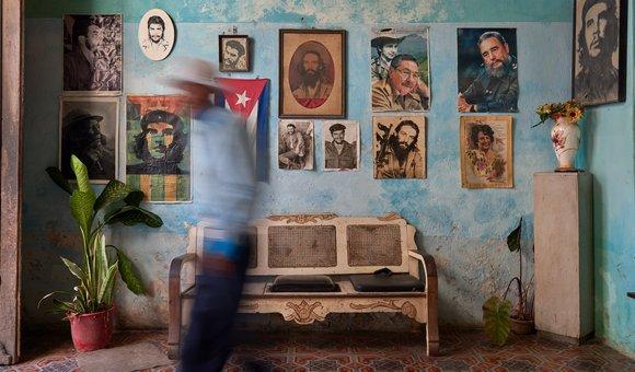 Portraits of Fidel and Raul Castro, Camilo Cienfuegos,  and Che Guevara on a wall in Havana, Cuba.