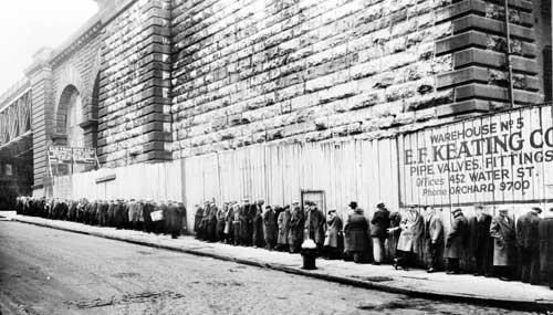 A not uncommon scene after the 1929 crash, a breadline gathers near the Brooklyn Bridge.