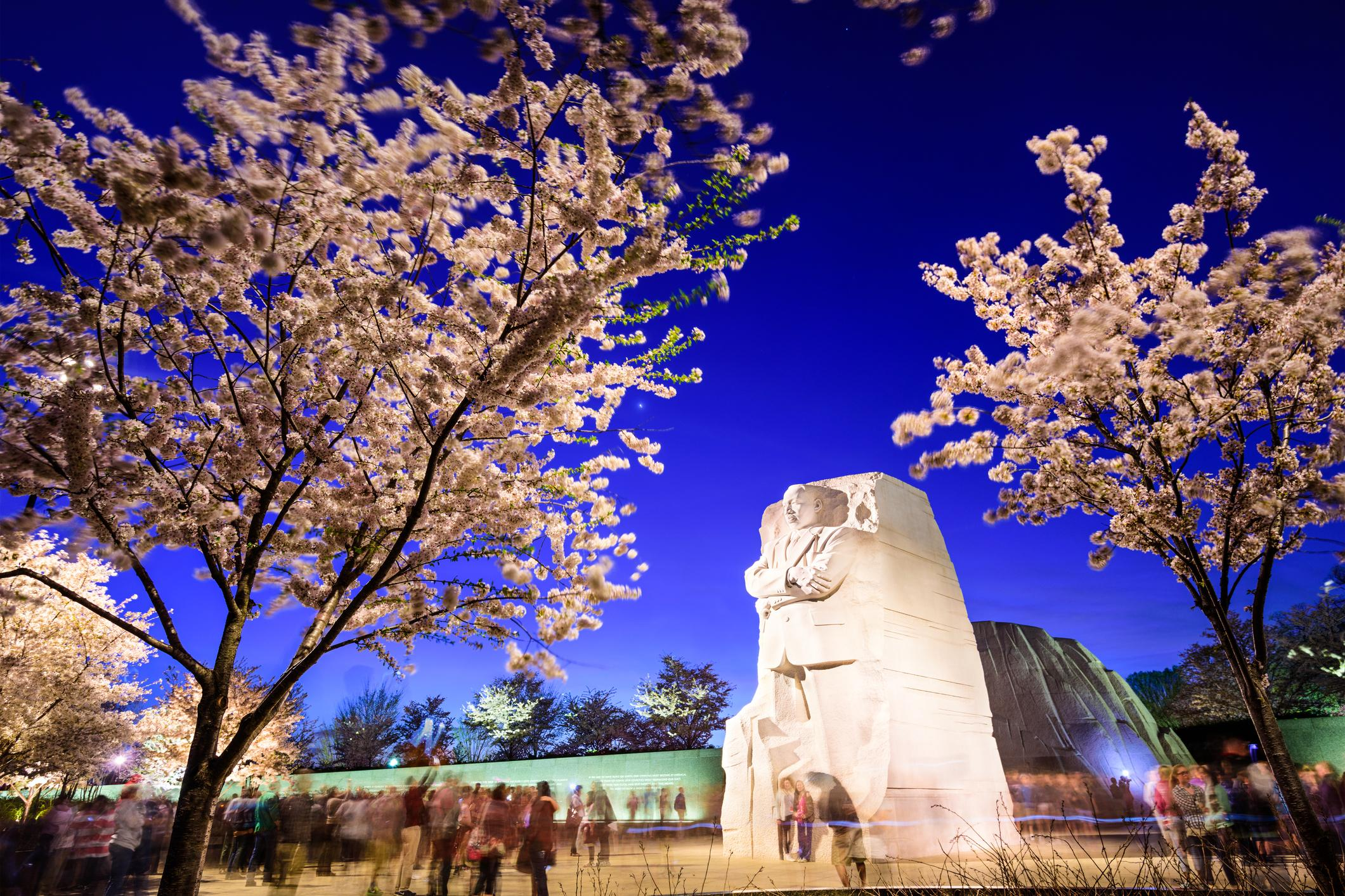 Tourists gather under the Martin Luther King, Jr. Memorial in West Potomac Park.
