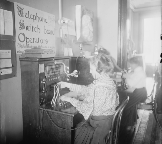 Women at telephone switchboards in the early 20th century