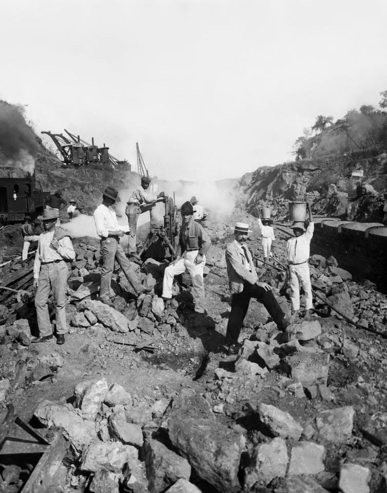 Work crew drilling through solid rock to create the Panama Canal, Panama, 1906