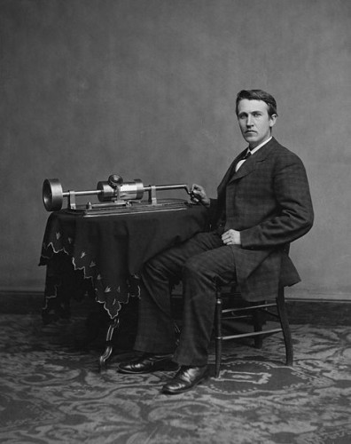 Thomas Edison poses with an early phonograph.
