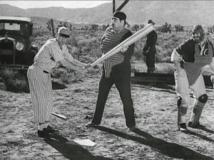 Buster Keaton tangles with umpire Dewey Robinson in One Run Elmer (1935)