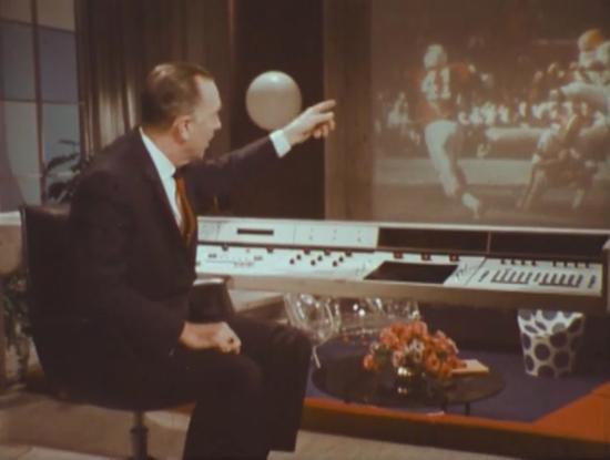 Walter Cronkite showing off the control panel