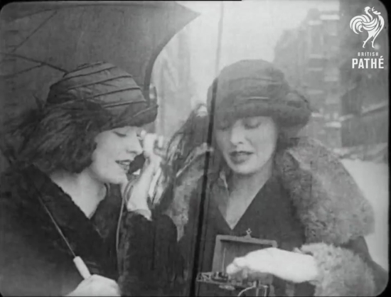 "Two women from the 1922 film ""Eve's Wireless"" operating a portable crystal radio"