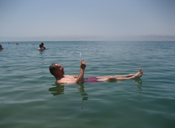 A man floats in the Dead Sea