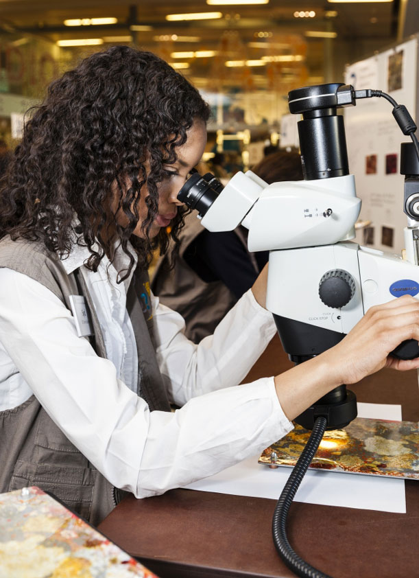 Authentic tools of the trade, like a scientist's microscopes, are on hand.