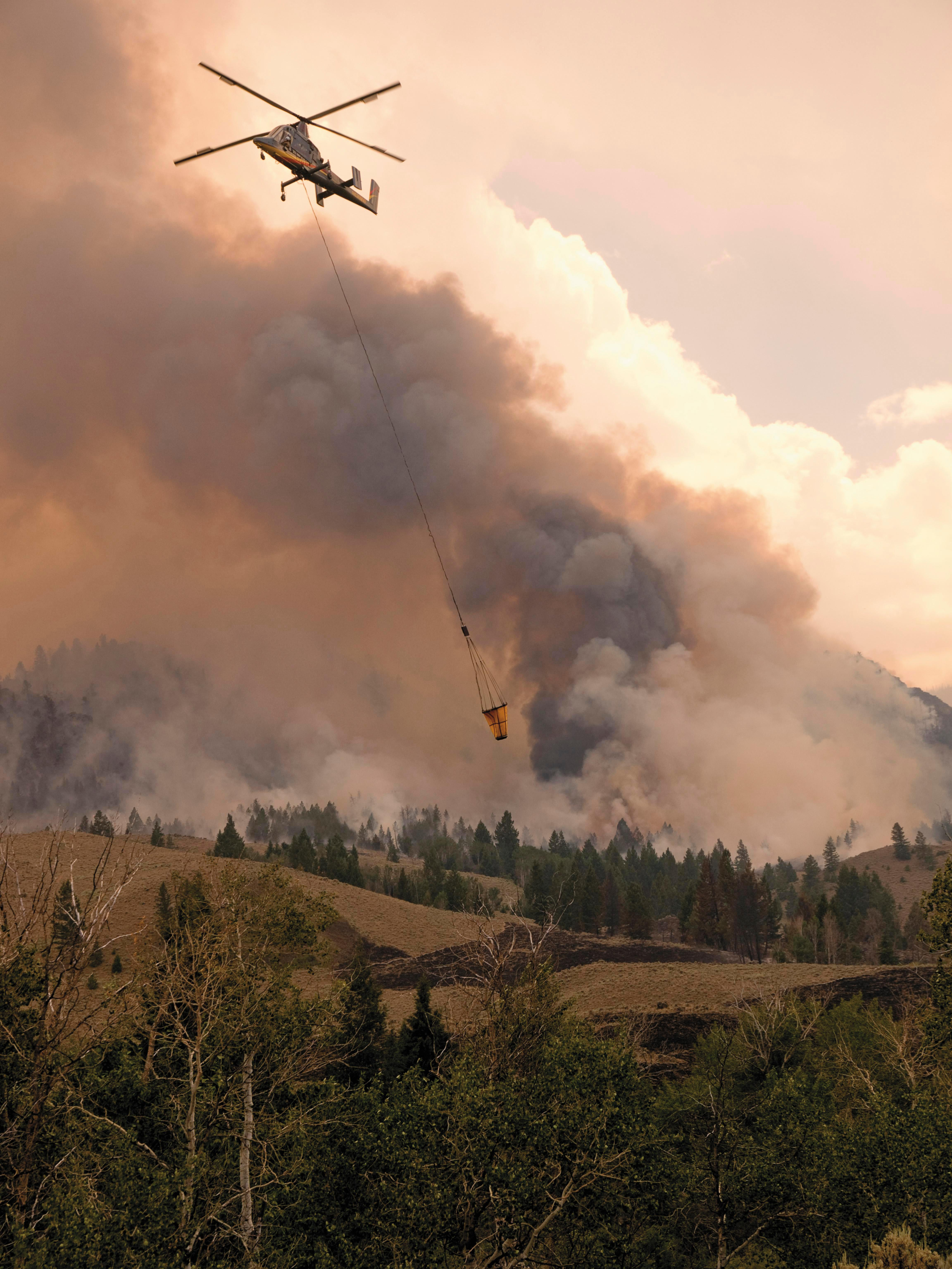 A crewed K-MAX auditions as a firefighter in Idaho in 2013. Drone K-MAXs have yet to fight real wildfires.
