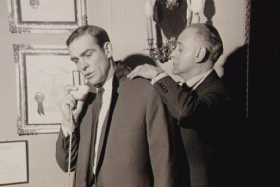 More tailoring of Connery's jacket by Sinclair at his shop on Conduit Street in London's Mayfair district