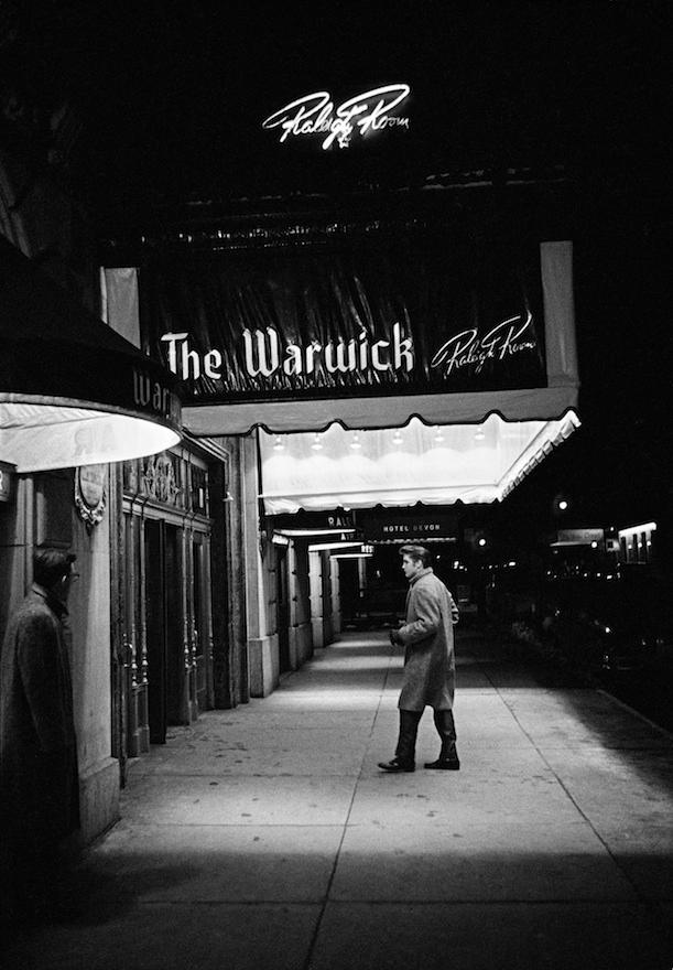 Alone, outside the Warwick Hotel
