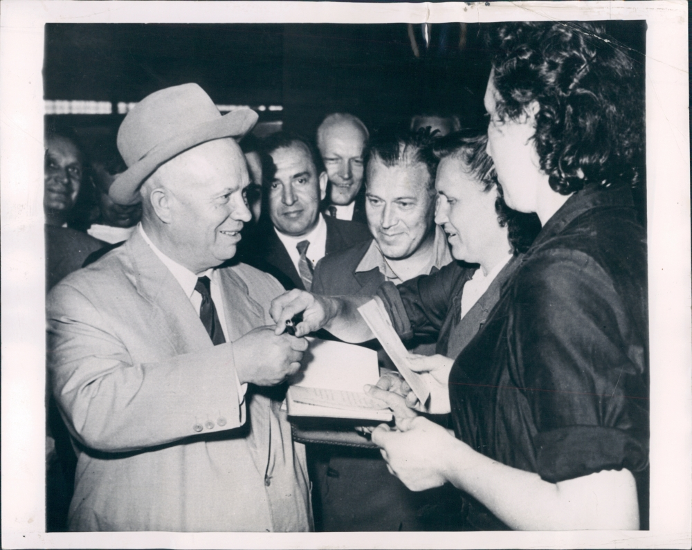"Khrushchev signs autographs for his ""fans""–workers at an Eastern bloc factory."