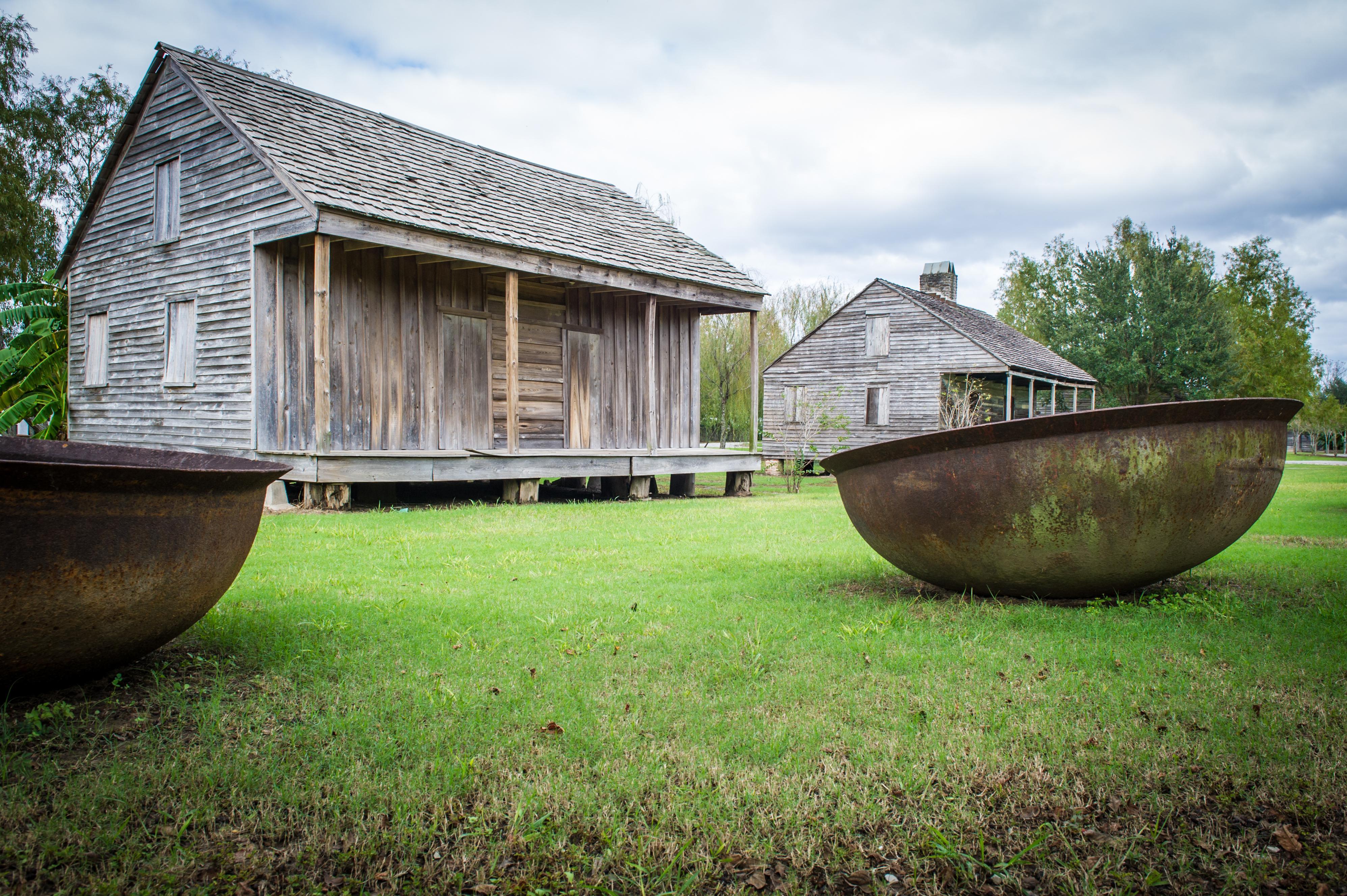 slave cabins and sugar kettles