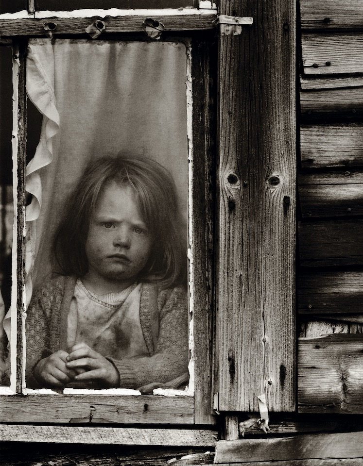 A young Walden resident, circa 1974, appears none too happy about being kept inside, or having her picture taken.