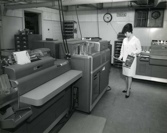 Woman with beehive working an IBM accounting machine, 1960s