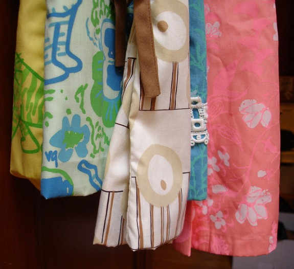 Two Lilly Pulitzer dresses on the far right along with Vested Gentress dresses.