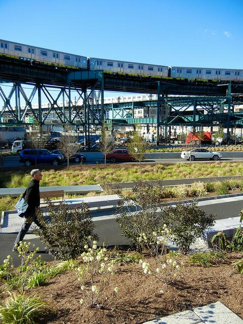 Ruddick transformed Queens Plaza by merging plants, water, wind and sun with the city's infrastructure.
