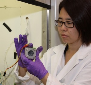 Engineer Hong Liu works with the fuel cell in the lab.