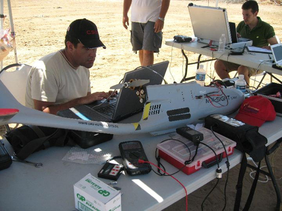 The unmanned drone's flight is monitored from a laptop
