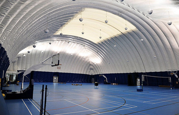 "A ""pollution dome"" covers the basketball courts at the Dulwich College in Beijing"