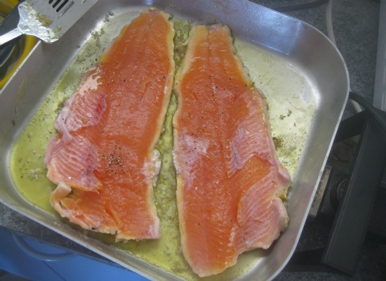 A reward of trout fishing: seasoned fillets simmering in olive oil.