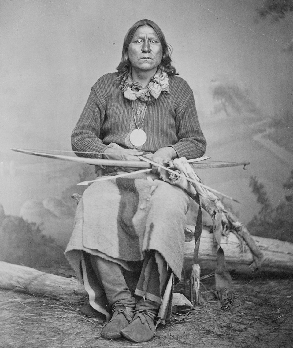 1024px-White_Bear_(Sa-tan-ta),_a_Kiowa_chief,_full-length,_seated,_holding_bow_and_arrows,_1869_-_1874_-_NARA_-_518901.jpg