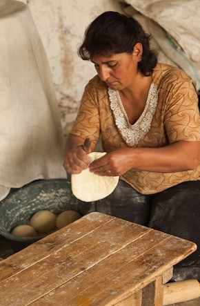 Rima prepares dough for baking