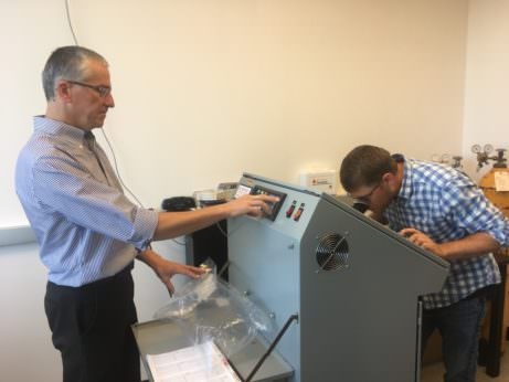 Jacek Koziel, left, and Devin Maurer analyze odor samples from a swine farm.