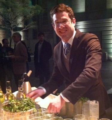 Adam Bernbach making drinks with organic local gin.