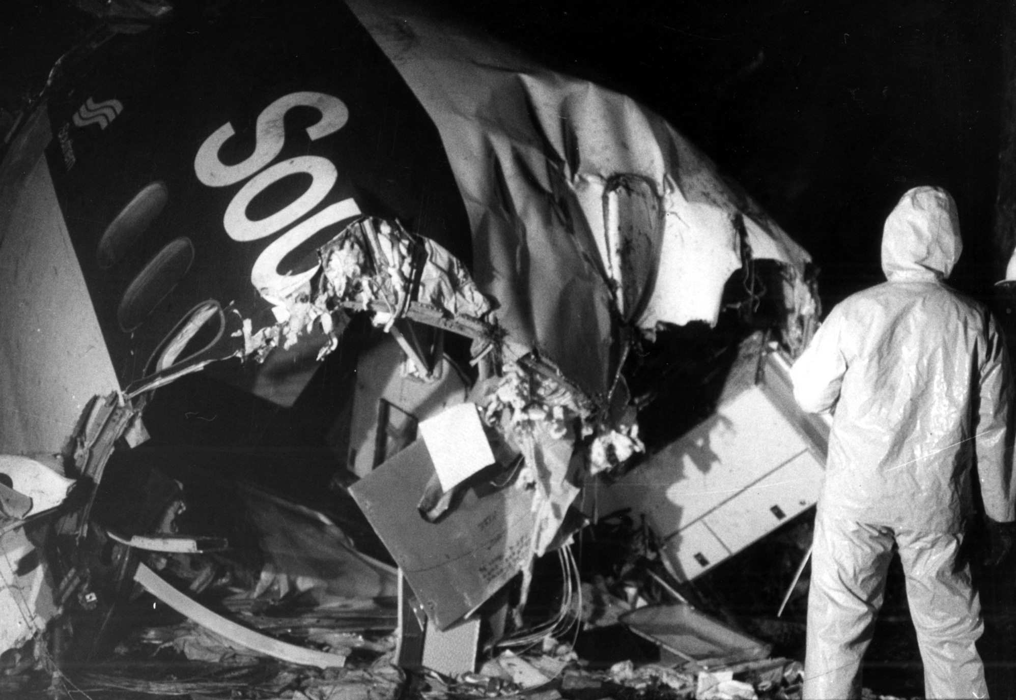 A worker searches through the wreckage