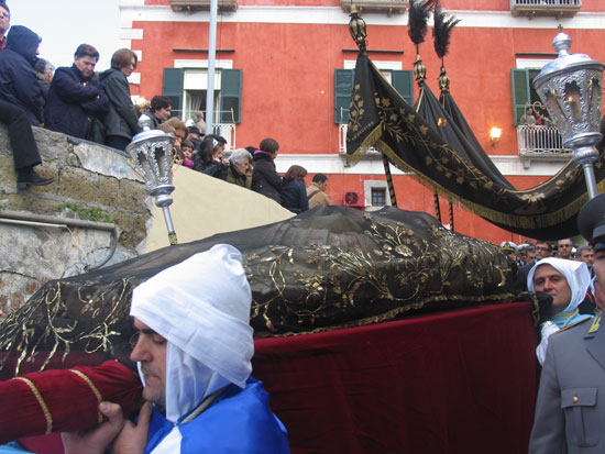 Christ's black-lace-covered catafalque