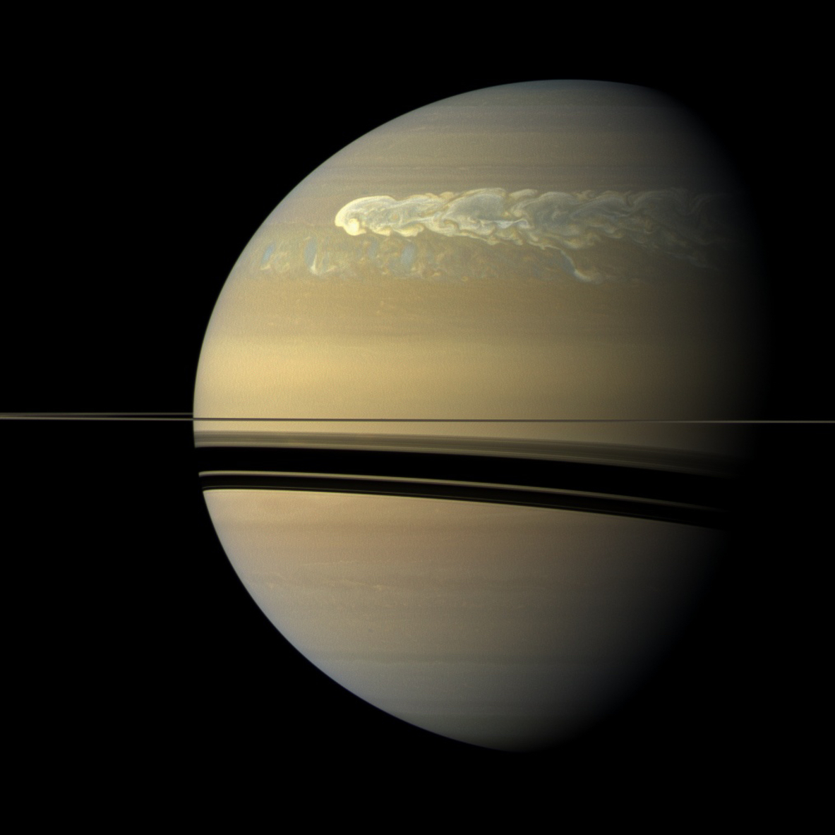 A huge storm churning across the face of Saturn