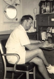 Lt. Minter Dial in the captain's cabin of the U.S.S. Napa, composing a letter in autumn of 1941.